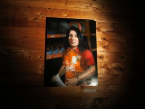 """Marina Abramovic depicted in """"Employee of the Month"""" (painting by Jim Krewson)"""